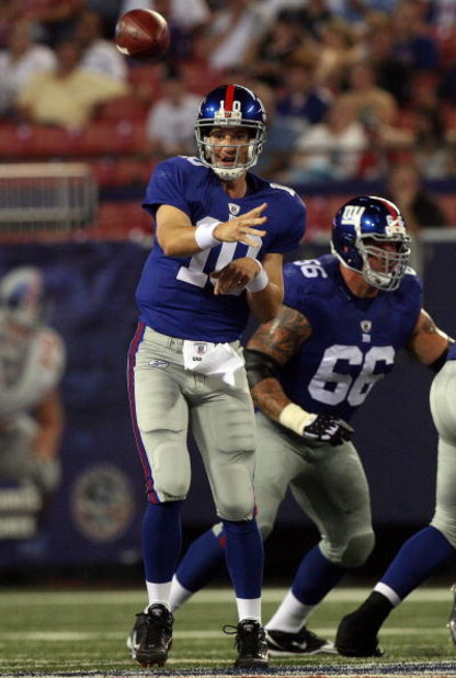 EAST RUTHERFORD, NJ - AUGUST 17:  Eli Manning #10 of the New York Giants throws a pass against the Carolina Panthers on August 17, 2009 at Giants Stadium in East Rutherford, New Jersey. The Giants defeated the Panthers 24-17.  (Photo by Jim McIsaac/Getty
