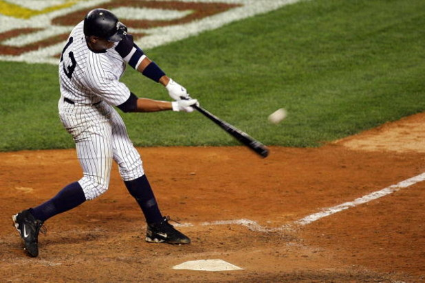 NEW YORK - OCTOBER 08:  Alex Rodriguez #13 of the New York Yankees hits a solo home run seventh inning against the Cleveland Indians during Game Four of the American League Division Series at Yankee Stadium on October 8, 2007 in the Bronx borough of New Y