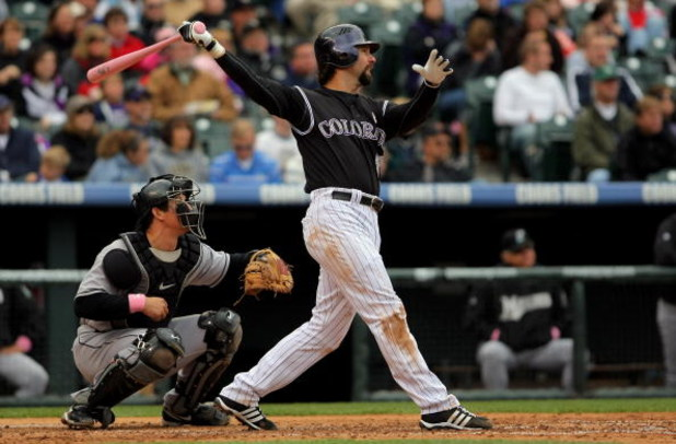 DENVER - MAY 10:  Todd Helton #17 of the Colorado Rockies takes an at bat against the Florida Marlins during MLB action at Coors Field on May 10, 2009 in Denver, Colorado. Helton went two for four as he was one of many players using pink bats in Major Lea