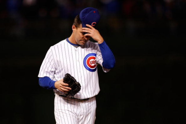 CHICAGO - OCTOBER 01:  Jim Edmonds #15 of the Chicago Cubs adjusts his hat against the Los Angeles Dodgers in Game One of the NLDS during the 2008 MLB Playoffs at Wrigley Field on October 1, 2008 in Chicago, Illinois. The Dodgers won 7-2. (Photo by Jamie