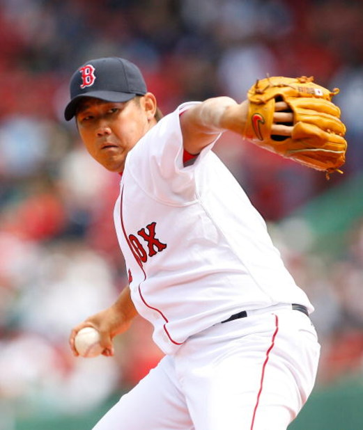 BOSTON - APRIL 9: Daisuke Matsuzaka #18 of the Boston Red Sox throws against the Tampa Bay Rays at Fenway Park April 9, 2009, in Boston, Massachusetts. The Rays won the game 4-3. (Photo by Jim Rogash/Getty Images)