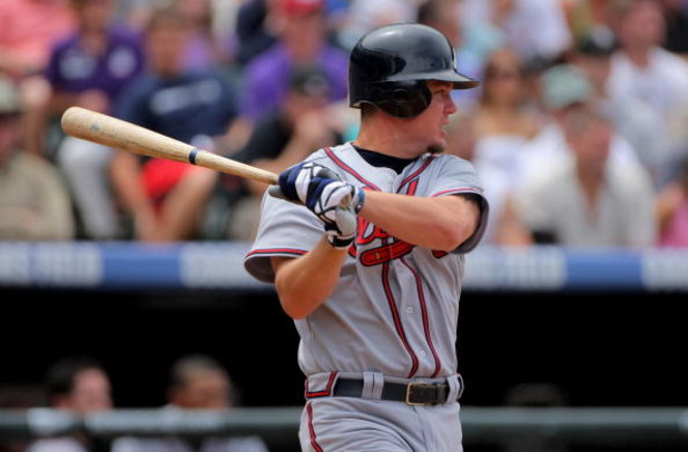 DENVER - JULY 12:  Chipper Jones #10 of the Atlanta Braves takes an at bat against the Colorado Rockies during MLB action at Coors Field on July 12, 2009 in Denver, Colorado. The Rockies defeated the Braves 8-7.  (Photo by Doug Pensinger/Getty Images)
