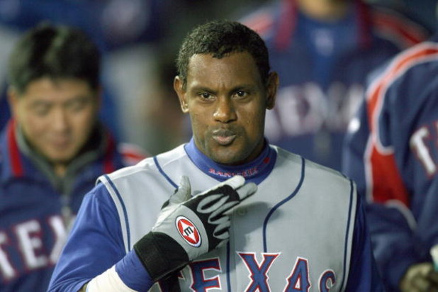 SEATTLE - APRIL 14: Sammy Sosa #21 of the Texas Rangers celebrates after hitting a two run homer against the Seattle Mariners on April 14, 2007 at Safeco Field in Seattle, Washington. (Photo by Otto Greule Jr/Getty Images)