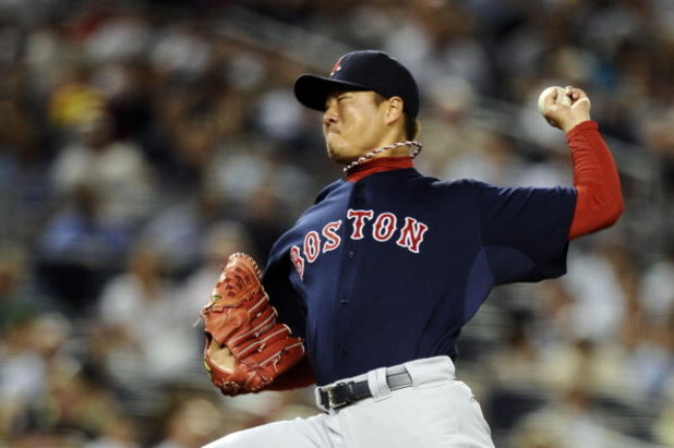 NEW YORK - AUGUST 07:  Relief pitcher Hideki Okajima #37 of the Boston Red Sox pitches against the New York Yankees on August 7, 2009 at Yankee Stadium in the Bronx borough of New York City.  (Photo by Jeff Zelevansky/Getty Images)