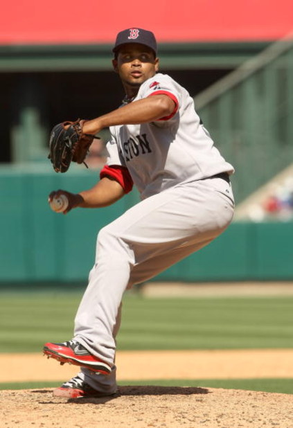 ANAHEIM, CA - MAY 14:  Pitcher Ramon Ramirez #56 of the Boston Red Sox throws a pitch against the Los Angeles Angels of Anaheim on May 14, 2009 at Angel Stadium in Anaheim, California.  (Photo by Stephen Dunn/Getty Images)