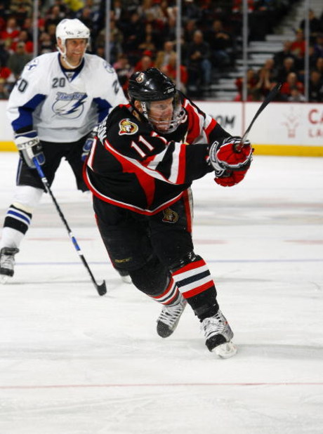 OTTAWA - MARCH 11:  Daniel Alfredsson #11 of the Ottawa Senators fires a slapshot from the top of the circle in a game against the Tampa Bay Lightning on March 11, 2009 at the Scotiabank Place in Ottawa, Canada. (Photo by Phillip MacCallum/Getty Images)