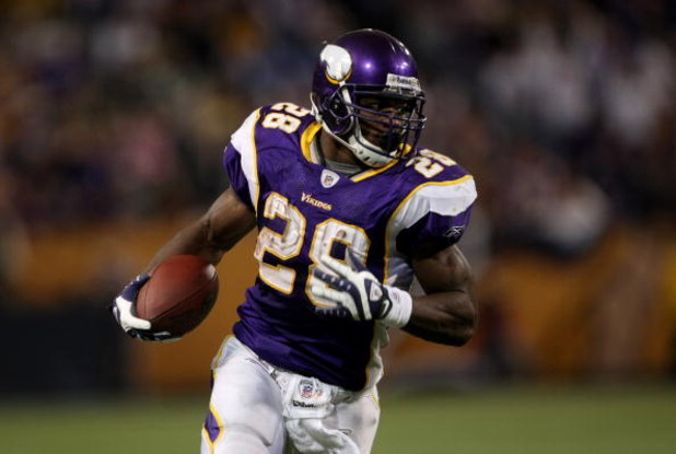 MINNEAPOLIS - NOVEMBER 09:  Adrian Peterson #29 of the Minnesota Vikings carries the ball on a 29 yard game winning touchdown run with 2:21 to play in the game against the Green Bay Packers on November 9, 2008 at the Metrodome in Mineapolis, Minnesota.  (