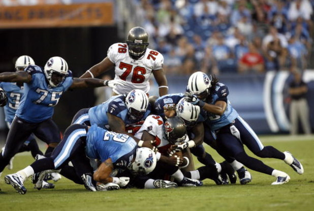 NASHVILLE, TN - AUGUST 15: The Tennessee Titans defense tackles Earnest Graham #34 of the Tampa Bay Buccaneers during a preseason NFL game at LP Field on August 15, 2009 in Nashville, Tennessee. (Photo by Joe Murphy/Getty Images)