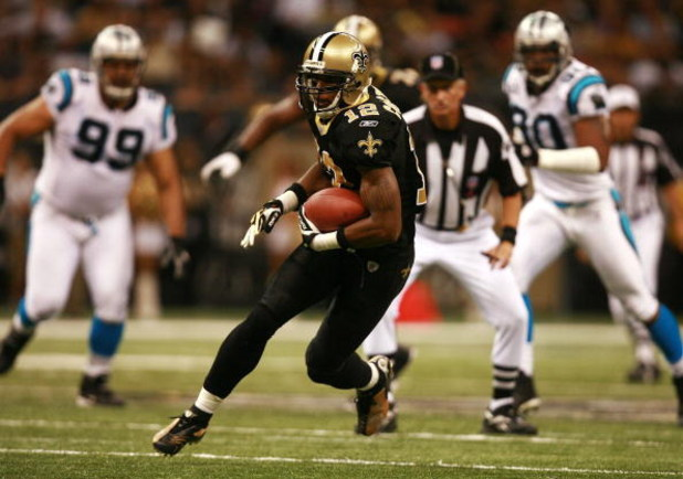 NEW ORLEANS - OCTOBER 07:  Wide receiver Marques Colston #12 of the New Orleans Saints looks for room to run while taking on the Carolina Panthers at the Superdome on October 7, 2007 in New Orleans, Louisiana. The Panthers defeated the Saints 16-13.  (Pho