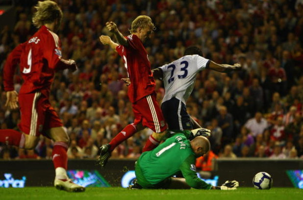 LIVERPOOL, ENGLAND - AUGUST 24:  Brad Friedel of Aston Villa dives to make a save at the feet of Dirk Kuyt of Liverpool during the Barclays Premier League match between Liverpool and Aston Villa at Anfield on August 24, 2009 in Liverpool, England.  (Photo