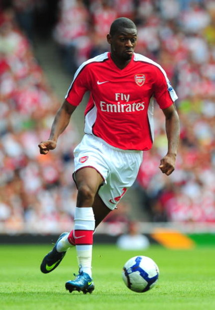 LONDON, ENGLAND - AUGUST 22:  Abou Diaby of Arsenal runs with the ball during the Barclays Premier League match between Arsenal and Portsmouth at the Emirates Stadium on August 22, 2009 in London, England.  (Photo by Mike Hewitt/Getty Images)