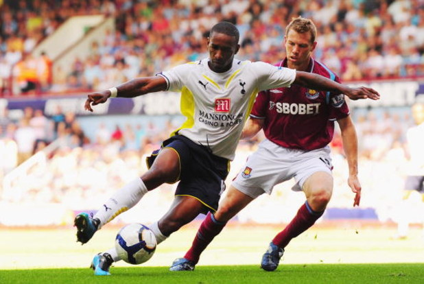 LONDON, ENGLAND - AUGUST 23:  Jermain Defoe of Tottenham is challenged by Jonathan Spector of West Ham during the Barclays Premier League match between West Ham United and Tottenham Hotspur on August 23, 2009 in London, England.  (Photo by Mike Hewitt/Get