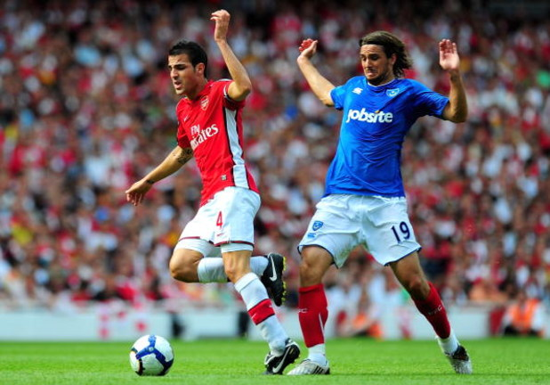 LONDON, ENGLAND - AUGUST 22:  Cesc Fabregas of Arsenal is challenged by Niko Kranjcar of Portsmouth during the Barclays Premier League match between Arsenal and Portsmouth at the Emirates Stadium on August 22, 2009 in London, England.  (Photo by Mike Hewi