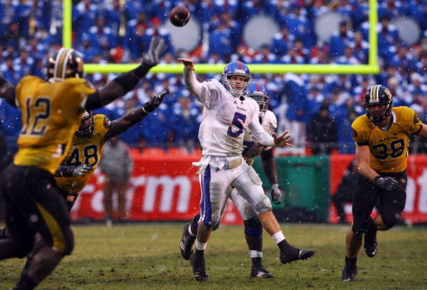 KANSAS CITY, MO - NOVEMBER 29:  Quarterback Todd Reesing #5 of the Kansas Jayhawks passes during the second half of the game against the Missouri Tigers on November 29, 2008 at Arrowhead Stadium in Kansas City, Missouri.  (Photo by Jamie Squire/Getty Imag
