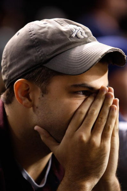 CHICAGO - OCTOBER 02:  Michael Piper, a fan of the Chicago Cubs looks on dejected against the Los Angeles Dodgers in Game Two of the NLDS during the 2008 MLB Playoffs at Wrigley Field on October 2, 2008 in Chicago, Illinois.  (Photo by Jamie Squire/Getty