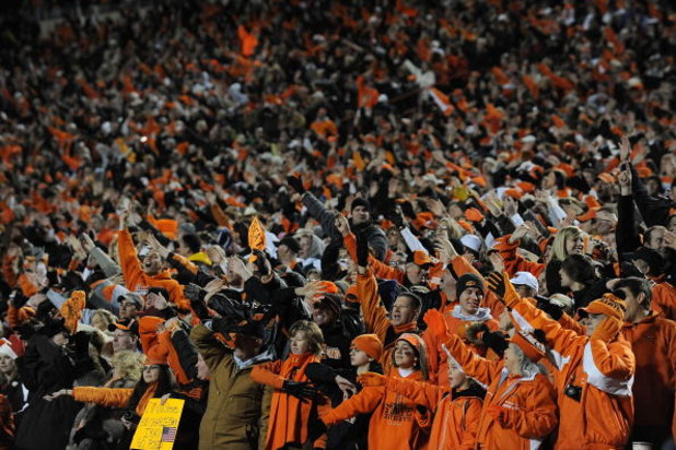 STILLWATER, OK - NOVEMBER 29:  Fans cheer during play between the Oklahoma Sooners and the Oklahoma State Cowboys at Boone Pickens Stadium on November 29, 2008 in Stillwater, Oklahoma.  (Photo by Ronald Martinez/Getty Images)