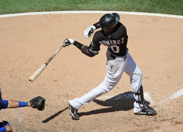 CHICAGO - JUNE 28: Alexei Ramirez #10 of the Chicago White Sox hits the ball against the Chicago Cubs on June 28, 2009 at U.S. Cellular Field in Chicago, Illinois. The White Sox defeated the Cubs 6-0. (Photo by Jonathan Daniel/Getty Images)