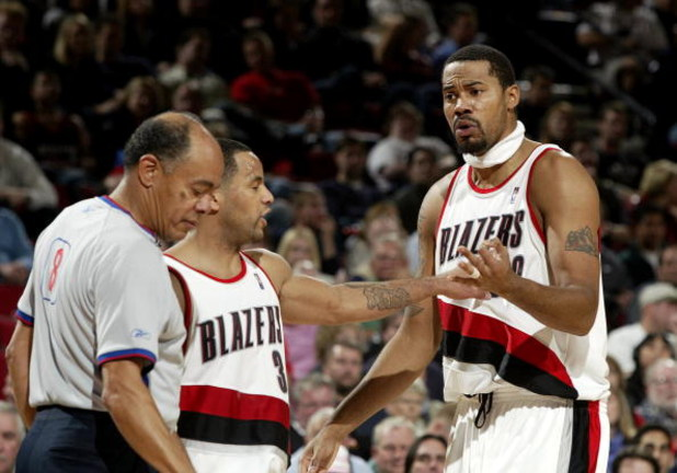 PORTLAND, OR - NOVEMBER 13:  Rasheed Wallace #30 of the Portland Trail Blazers argues with the referee as teammate Damon Stoudamire #3 holds him back during a NBA game against the Sacramento Kings November 13, 2003 at the Rose Garden in Portland, Oregon.