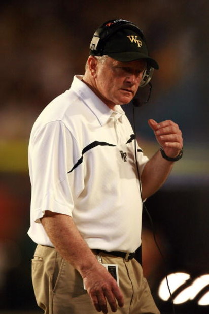 MIAMI GARDENS, FL - JANUARY 02:  Head coach Jim Grobe of the Wake Forest Demon Deacons looks on from the sidelines against the Louisville Cardinals during the 2007 FedEx Orange Bowl at Dolphin Stadium on January 2, 2007 in Miami Gardens, Florida.  (Photo