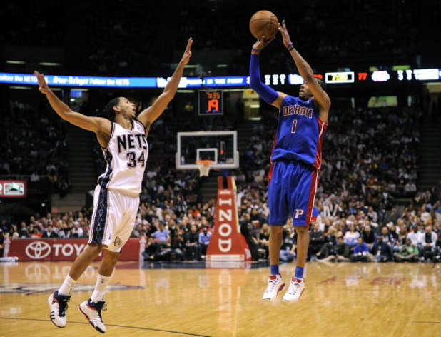 EAST RUTHERFORD, NJ - NOVEMBER 07:  Devin Harris #34 of the New Jersey Nets guards Allen Iverson #1 of the Detroit Pistons in their game November 7, 2008 at the Izod Arena in East Rutherford, New Jersey.  (Photo by Jeff Zelevansky/Getty Images)