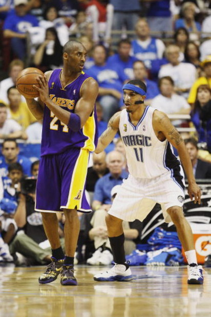 ORLANDO, FL - JUNE 14:  Kobe Bryant #24 of the Los Angeles Lakers looks to move the ball against Courtney Lee #11 of the Orlando Magic in Game Five of the 2009 NBA Finals on June 14, 2009 at Amway Arena in Orlando, Florida. The Lakers won 99-86.  NOTE TO