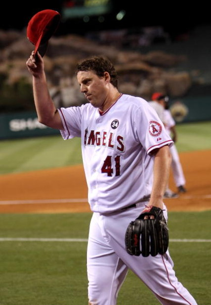ANAHEIM, CA - JULY 24:  John Lackey #41 of the Los Angeles Angels of Anaheim tips his cap to the crowd after being relieved in the eighth inning against the Minnesota Twins on July 24, 2009 at Angel Stadium in Anaheim, California.  (Photo by Stephen Dunn/
