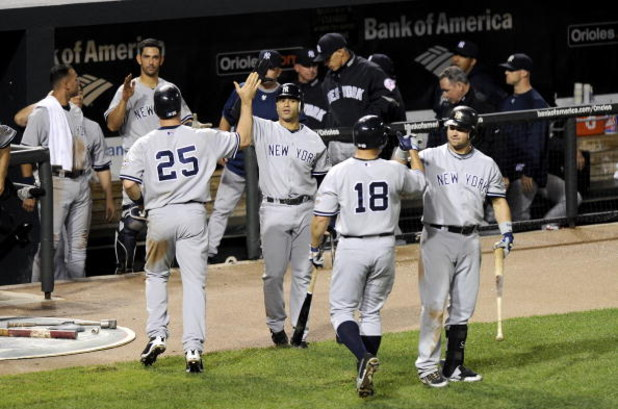 BALTIMORE - AUGUST 31:  Mark Teixeira #25 and Johnny Damon #18 of the New York Yankees are congratulated by Jerry Hairston Jr. #17 and Nick Swisher #33 after scoring in the eighth inning against the Baltimore Orioles on August 31, 2009 at Camden Yards in