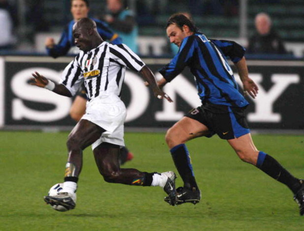 TURIN, ITALY - NOVEMBER 29:  Appiah of Juventus and C. Zanetti of Inter in action during the Italian Serie A 11th round match between Juventus and Inter at Delle Alpi Stadium on November 29, 203 in Turin, Italy.  (Photo by Getty Images)