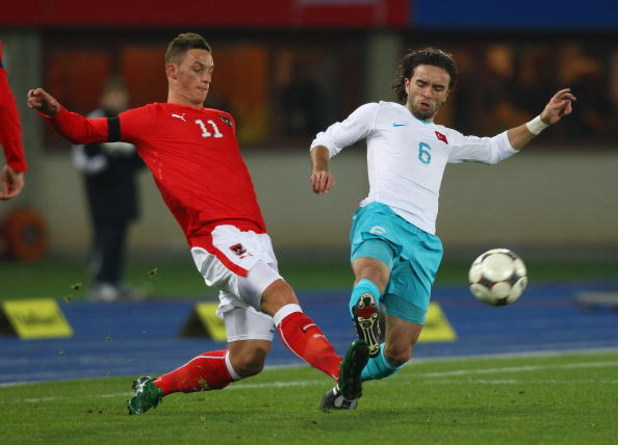 VIENNA, AUSTRIA - NOVEMBER 19:  Marko Arnautovic  (L) of Austria competes for the ball against Gokhan Gonul (R) of Turkey during the International Friendly match between Austria and Turkey at Ernst Happel Stadion on November 19, 2008 in Vienna, Austria.