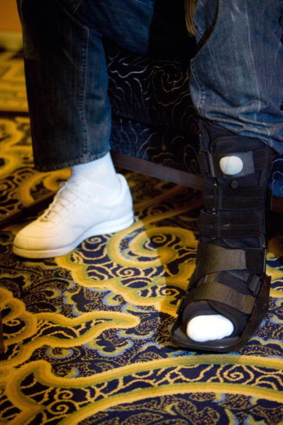 BEIJING, CHINA - APRIL 04:  The injured foot of NBA Star Yao Ming is seen as he  answers a question about Olympics and his foot injury during a news conference on April 4, 2008 in Beijing, China. Yao Ming will try the therapeutic method of Chinese medicin