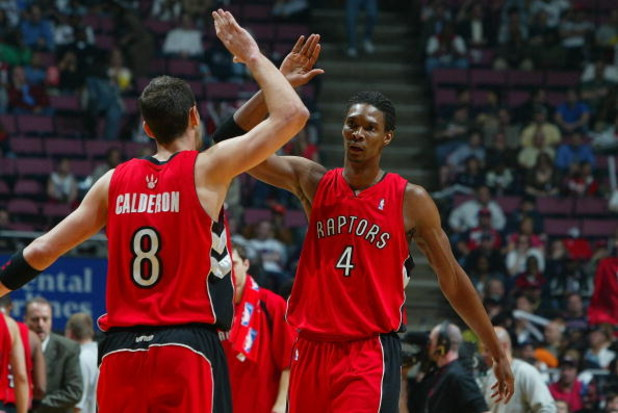 EAST RUTHERFORD, NJ - MAY 04:   Chris Bosh #4 and Jose Calderon #8 of the Toronto Raptors high five during a break in play against the New Jersey Nets in Game Six of the Eastern Conference Quarterfinals during the 2007 NBA Playoffs on May 4, 2007 at the C