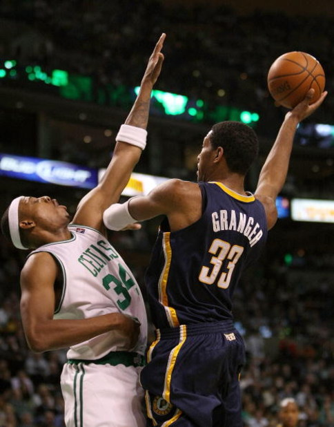 BOSTON - DECEMBER 03: Paul Pierce #34 of the Boston Celtics tries to block a pass by Danny Granger #33 of the Indiana Pacers on December 3, 2008 at TD Banknorth Garden in Boston, Massachusetts. The Celtics defeated the Pacers 114-96. NOTE TO USER: User ex