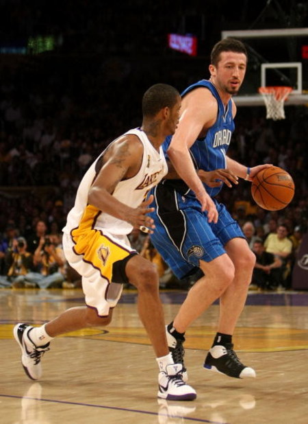 LOS ANGELES, CA - JUNE 07:  Hedo Turkoglu #15 of the Orlando Magic drives on Trevor Ariza #3 of the Los Angeles Lakers in Game Two of the 2009 NBA Finals at Staples Center on June 7, 2009 in Los Angeles, California. NOTE TO USER: User expressly acknowledg