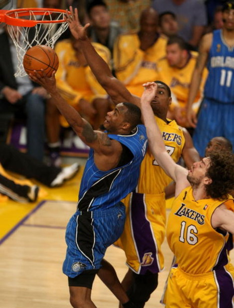 LOS ANGELES, CA - JUNE 04:  Rashard Lewis #9 of the Orlando Magic goes up for a shot against Andrew Bynum #17 and Pau Gasol #16 of the Los Angeles Lakers in the second half of Game One of the 2009 NBA Finals at Staples Center on June 4, 2009 in Los Angele
