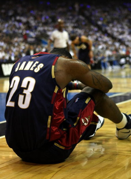 ORLANDO, FL - MAY 30: LeBron James #23 of the Cleveland Cavaliers sits on the court after being fouled by the Orlando Magic in Game Six of the Eastern Conference Finals during the 2009 Playoffs at Amway Arena on May 30, 2009 in Orlando, Florida. NOTE TO U
