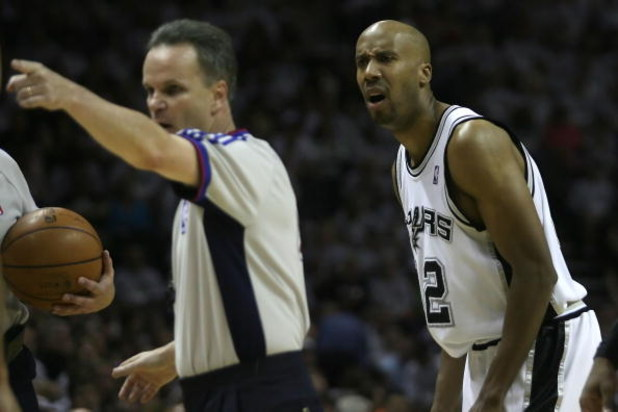 SAN ANTONIO - MAY 25:  Bruce Bowen #12 of the San Antonio Spurs reacts to a call by referee Mike Callahan #24 while taking on the Los Angeles Lakers in Game Three of the Western Conference Finals during the 2008 NBA Playoffs on May 25, 2008 at the AT&T Ce