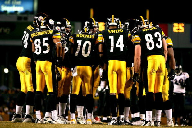 PITTSBURGH - JANUARY 18:  (L-R) Nate Washington #85, Santonio Holmes #10, Limas Sweed #14 and Heath Miller #83 of the Pittsburgh Steelers stand in the huddle against the Baltimore Ravens during the AFC Championship game on January 18, 2009 at Heinz Field