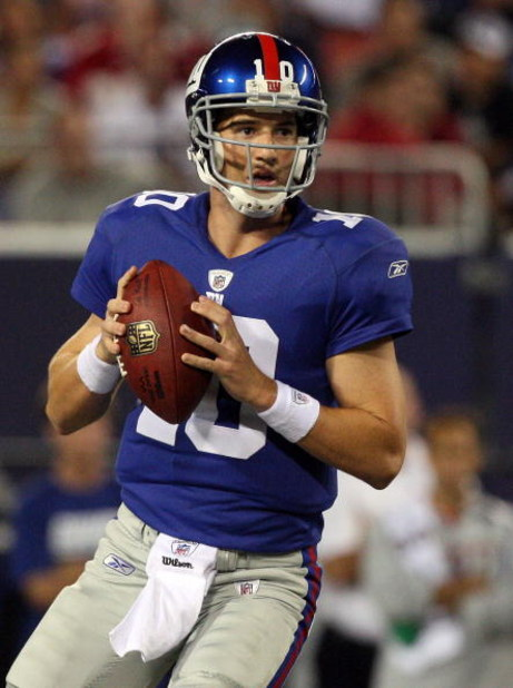 EAST RUTHERFORD, NJ - AUGUST 29:  Eli Manning #10 of the New York Giants looks to throw a pass against the New York Jets on August 29, 2009 at Giants Stadium in East Rutherford, New Jersey.  (Photo by Jim McIsaac/Getty Images)