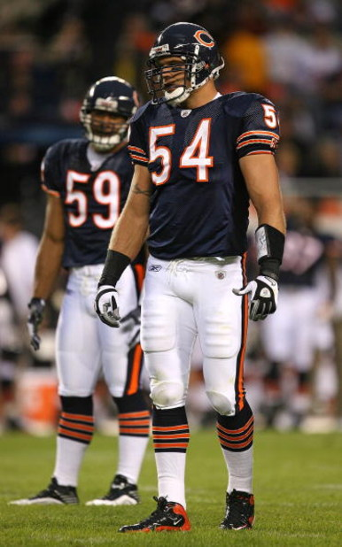 CHICAGO - AUGUST 22: Brian Urlacher #54 and Pisa Tinoisamoa #59 of the Chicago Bears wait for the start of play against the New York Giants during a pre-season game on August 22, 2009 at Soldier Field in Chicago, Illinois. The Bears defeated the Giants 17