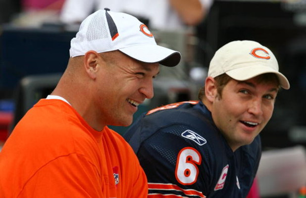 CHICAGO - OCTOBER 04: Injured linebacker Brian Urlacher #54 of the Chicago Bears laughs with Jay Cutler #6 on the bench during a game against the Detroit Lions on October 4, 2009 at Soldier Field in Chicago, Illinois. The Bears defeated the Lions 48-24. (