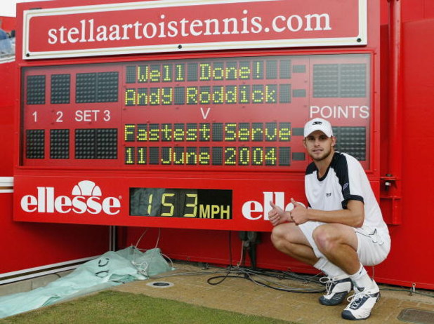 LONDON - JUNE 12:   Andy Roddick of the USA poses next to the official scoreboard showing his world record serve speed after his victory over Lleyton Hewitt of Australia in the semi-final match at the Stella Artois Tennis Championships at the Queen?s Club