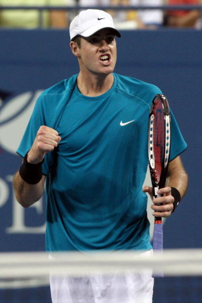 NEW YORK - SEPTEMBER 05:  John Isner reacts after a point against Andy Roddick during day six of the 2009 U.S. Open at the USTA Billie Jean King National Tennis Center on September 5, 2009 in the Flushing neighborhood of the Queens borough of New York Cit