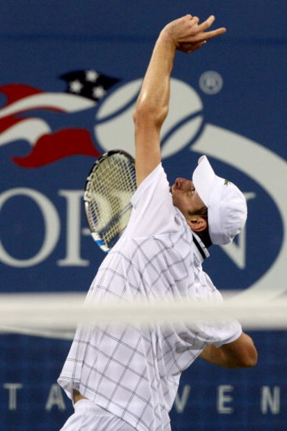 NEW YORK - SEPTEMBER 05:  Andy Roddick serves to John Isner during day six of the 2009 U.S. Open at the USTA Billie Jean King National Tennis Center on September 5, 2009 in the Flushing neighborhood of the Queens borough of New York City.  (Photo by Jim M