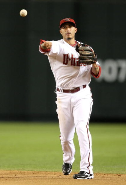 PHOENIX - JULY 10:  Infielder Felipe Lopez #2 of the Arizona Diamondbacks fields a ground ball out against the Florida Marlins during the major league baseball game at Chase Field on July 10, 2009 in Phoenix, Arizona. The Diamondbacks defeated the Marlins