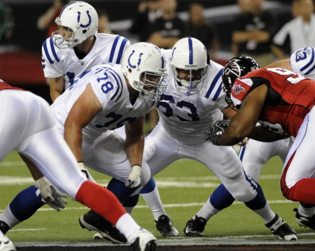 ATLANTA - AUGUST 16: Offensive guard Mike Pollak #78 and center Jeff Saturday #63 of the Indianapolis Colts set to block against the Atlanta Falcons at the Georgia Dome on August 16, 2008 in Atlanta, Georgia.   (Photo by Al Messerschmidt/Getty Images)