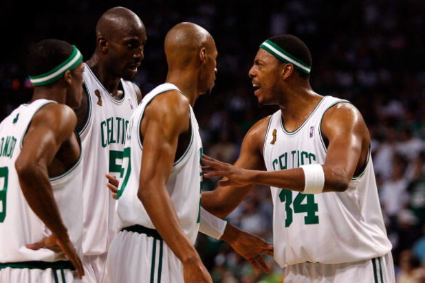 BOSTON - JUNE 17:  (L-R) Rajon Rondo #9, Kevin Garnett #5 and Ray Allen #20 listen to teammate Paul Pierce #34 of the Boston Celtics in the third quarter of Game Six of the 2008 NBA Finals against the Los Angeles Lakers on June 17, 2008 at TD Banknorth Ga