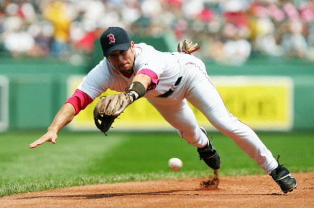 BOSTON - JULY 22:   (FILE PHOTO )  Nomar Garciaparra #5 of the Boston Red Sox dives for a ball hit by Jerry Hairston #15 of the Baltimore Orioles in the second inning July 22, 2004 at Fenway Park in Boston, Massachusetts. After spending nine-years in Bost