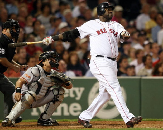 BOSTON - SEPTEMBER 08:  David Ortiz #34 of the Boston Red Sox hits a solo home run in the seventh inning as Matt Wieters #15 of the Baltimore Orioles defends on September 8, 2009 at Fenway Park in Boston, Massachusetts.  (Photo by Elsa/Getty Images)