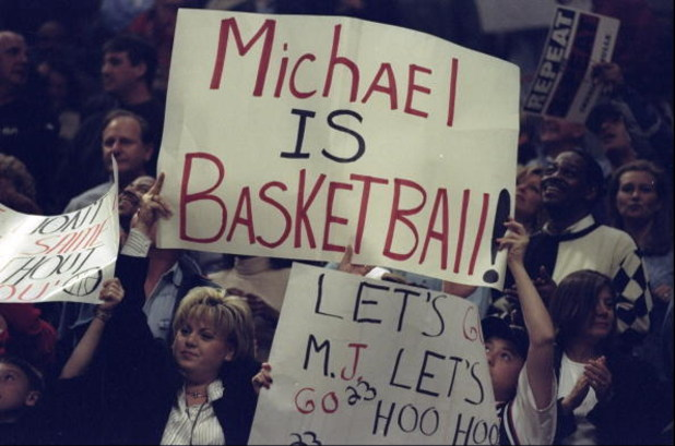 18 Apr 1998:  Fans of Michael Jordan #23 of the Chicago Bulls hold up signs during a game against the New York Knicks at the United Center in Chicago, Illinois. The Bulls defeated the Knicks 111-109. Mandatory Credit: Jonathan Daniel  /Allsport