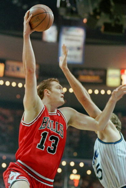 27 May 1996: Luc Longley #13 of the Chicago Bulls shoots the ball over Jon Koncak #45 of the Orlando Magic during the first quarter of game 4 of the Eastern Conference Final between the Chicago Bulls and the Orlando Magic at the Orlando Arena in Orlando,